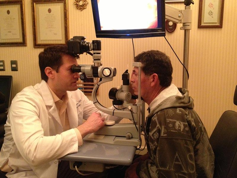 Dr. Aldave examining a patient prior to surgery