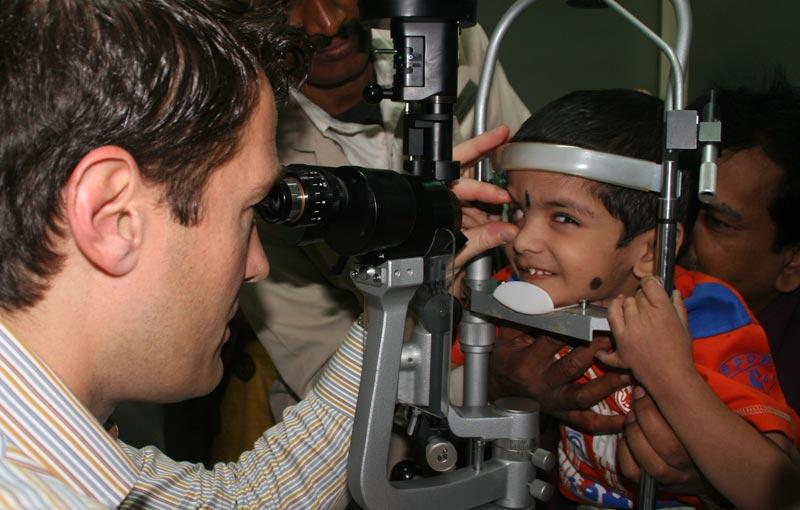 Dr. Aldave examines a child at the Bangalore West Lions Super Specialty Eye Hospital.