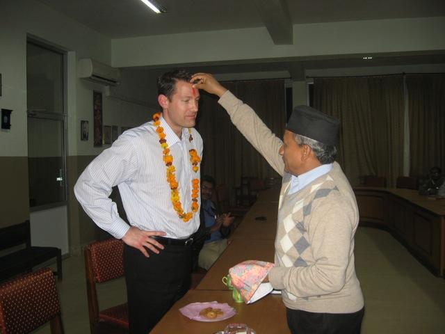 Dr. Aldave receiving blessing and garland to welcome him to Lumbini Eye Institute.