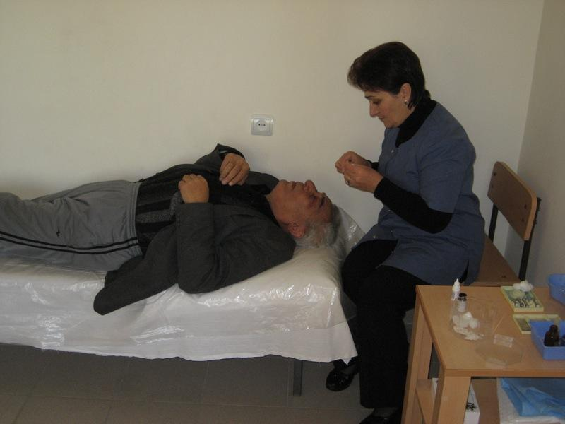Ophthalmic assistant measuring the intraocular pressure in a patient at the Malayan Eye Hospital