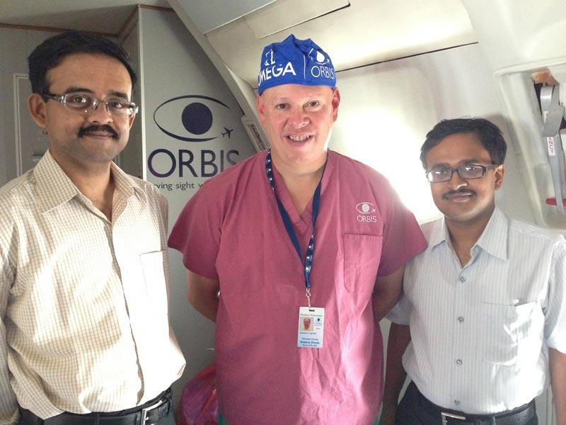 Dr. Pineda on board the ORBIS Flying Eye Hospital with Drs. S Das and M Das