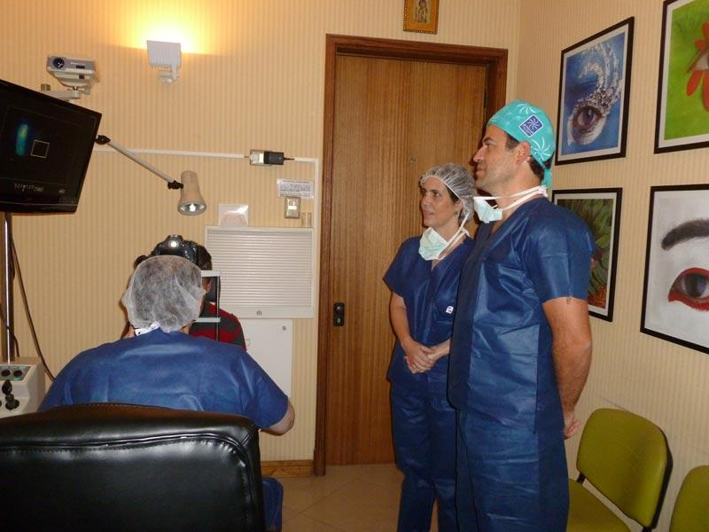 Drs. Sebastian Perez and Andrea Cruzat observing while Dr. Aldave examines a patient