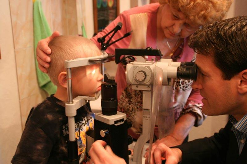 Dr. Aldave examining a young patient at the Fyodorov Eye Institute