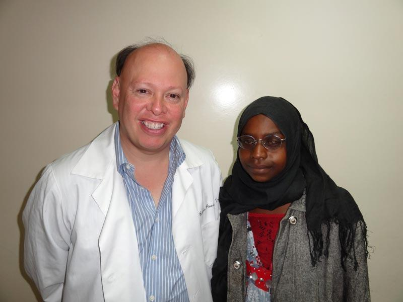 Dr. Pineda with a patient who received an artificial corneal transplant.