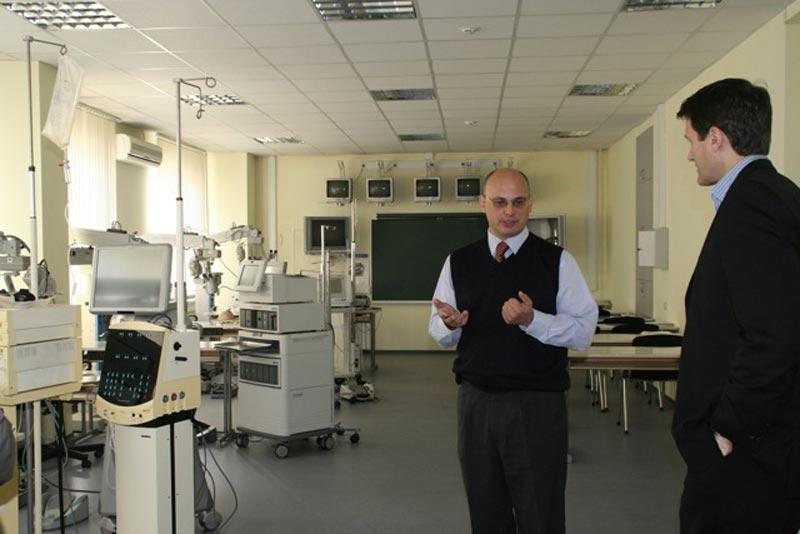 Dr. Aldave receives a tour of the surgical training facility at the Fyodorov Eye Institute