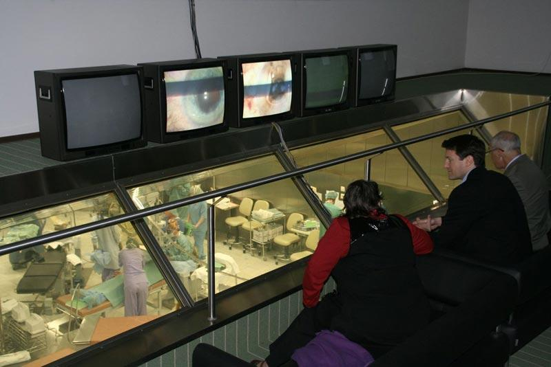 Dr. Aldave observing surgery being performed from a viewing room above the operating room at the Fyodorov Eye Institute